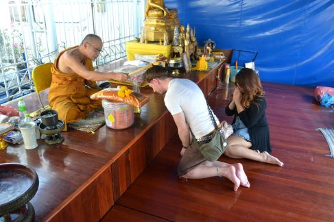 Being blessed by a monk with my good friends Allan and FF in Bangkok.