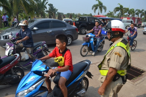 young child on motorbike thailand issan songkran