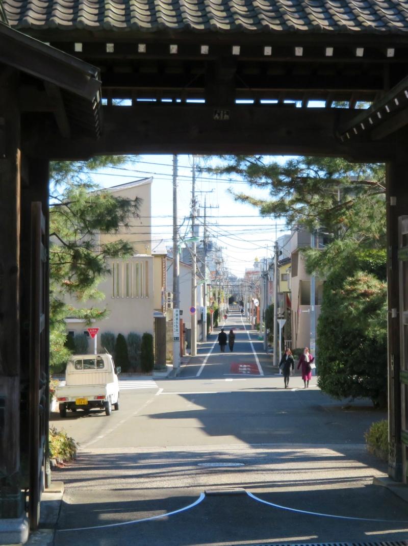 Temple gates Tokyo sun
