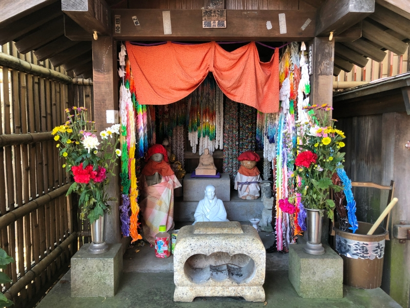 cute statues colour japanese shrine