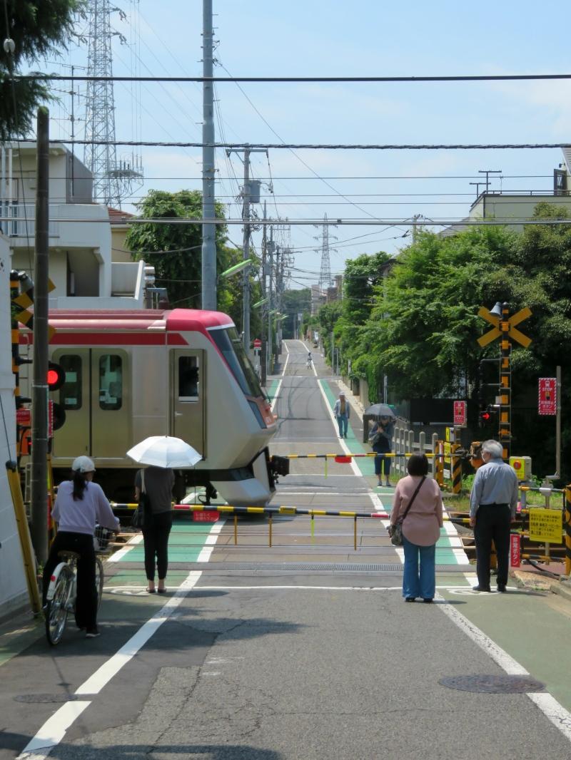 train passing street neighbourhood suburbs tokyo japan